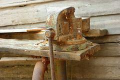 Stock Photo of Old rustu all-steel vice on obsolete wooden workbench