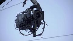 Broadcast,news camera on crane filming in the city Stock Footage