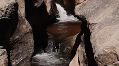 Slow motion cool waterfall in a slot canyon in southern utah Stock Footage