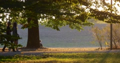 Two Young Girls Are Walking by the Road Middle Aged Couple behing the Hill Man Stock Footage