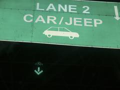 A sign board showing a lane number for car and jeeps at a toll Pune, Maharash Stock Photos