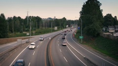 Busy Highway Near Houses In Evening Light Stock Footage