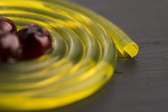 Stock Photo of molecular fruit spaghetti with rowan in syrup