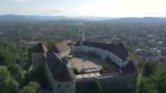 Aerial - Castle dominating the Ljubljana city skyline Stock Footage
