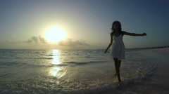 Stock Video Footage of African American girl in white clothes enjoying tropical beach sunrise