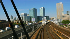 Train passing by residential buildings, moving towards downtown London - stock footage