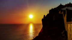Sun going down over uluwatu temple bali time lapse Stock Footage