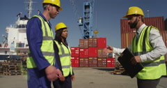Stock Video Footage of A businessman greets his partners and discuss logistics for shipment.