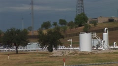 Gas pipeline and power grid in background Stock Footage