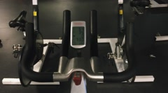 Cool shot of LCD monitor display and handles of a spinning bike Stock Footage