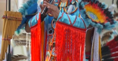 Costume Close Up Man Playing Flute and Dancing Indians Performers in National Stock Footage