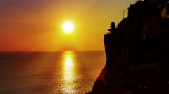 Sunset  behind uluwatu temple bali time lapse zoom out Stock Footage
