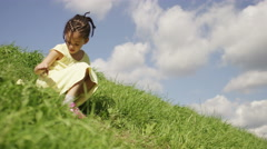 4K Little girl on a hill, in slow motion,  shot on Red Epic Dragon Stock Footage