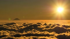 Time lapse from above a sea of  clouds sun going down Stock Footage