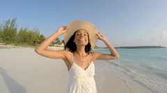 Portrait of ethnic girl in casual white clothes on tropical beach Stock Footage