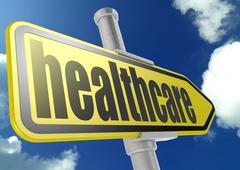Yellow road sign with healthcare word under blue sky - stock photo