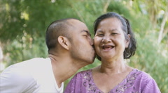 Son kiss his 60 years old mother Stock Footage
