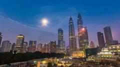 Beautiful Kuala Lumpur, Malaysia sunrise with moon rise. Time lapse. 4K. Pan. Stock Footage