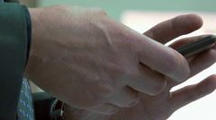 Businessman using smartphone iphone - texting typing, work meeting - close up 2 Stock Footage