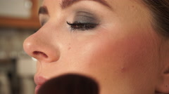 Makeup artist applying rouge to model face 4K Stock Footage
