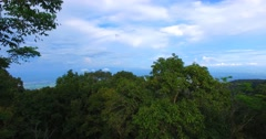 Rising craneshot above forest to Chiangmai cityview Stock Footage