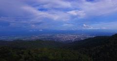 4k aerial towards Chiangmai above mountain Stock Footage