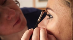 Stock Video Footage of  Makeup artist coloring applying brown color to female eyebrow 4K