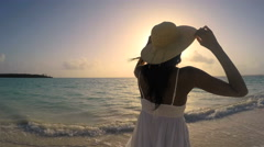 African American girl in white clothes enjoying tropical beach Stock Footage