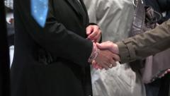 Businessmen - handshakes in a business meeting - close up Stock Footage