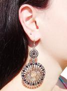 earrings jewellery with bright crystals in ear - stock photo