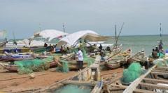Ghana african fisherman boats near ocean 4K Stock Footage