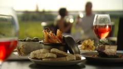 Romantic couple alfresco fine dining Stock Footage