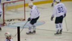 Hockey players warming up before the game on the court. No focus. - stock footage