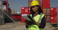 An African American inspector at a commercial dock. Shot on RED Epic. Stock Footage