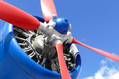 Airplane engine with red propeller - stock photo