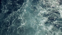 Ship/boat wake as it leaves the port,slow motion,high angle Stock Footage