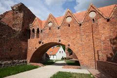 Teutonic Knights Castle Gate in Torun Stock Photos
