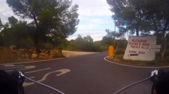 Road bike rider downhill on asphalt curving road, time-lapse Stock Footage