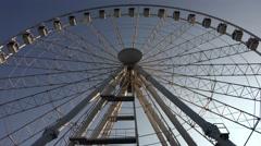Ferris wheel against the blue sky. 4K Stock Footage