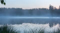 Panning timelapse shot of foggy lake in morning Stock Footage