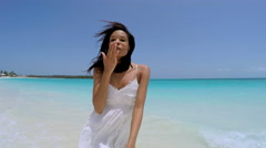 Social media selfie of ethnic girl in white dress on the beach Stock Footage