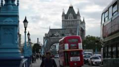 Tower bridge and red busses Stock Footage