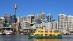 Tracking shot of a Sydney ferry departing Darling harbour wharf in 4k Stock Footage