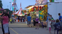 Fairground Midway At Dusk Lights Flashing Stock Footage