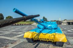 Yellow-blue color T-64 tank in Kiev near Mother Motherland statue Stock Photos