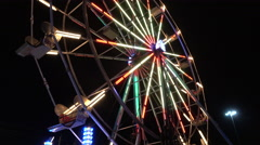 Fairground Ferris Wheel Turning At Night - stock footage