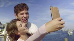 Fun Couple Pose, Smile, Make Funny Faces For Selfies On Vacation Stock Footage
