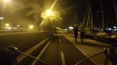 Road bike rider on night bicycle path in Palma, Mallorca Stock Footage