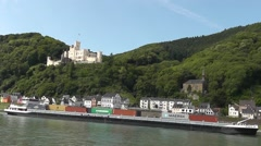 A container boat on the Rhine driving past Stolzenfels castle, Koblenz, Germany Stock Footage