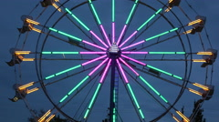 Close Up Of A Ferris Wheel Light Up At Night During A Fair Stock Footage